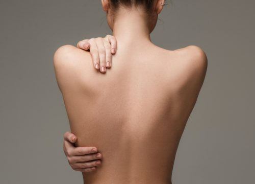 Woman with smooth back following hair removal