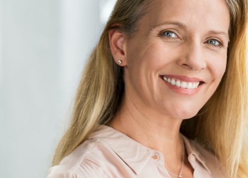 Happy middle-age woman after ThreeForMe treatments