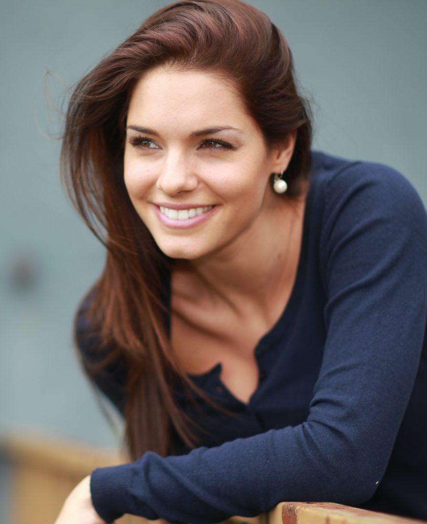 Attractive brunette in a navy shirt